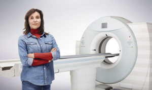 Image of woman standing in front of medical scanner