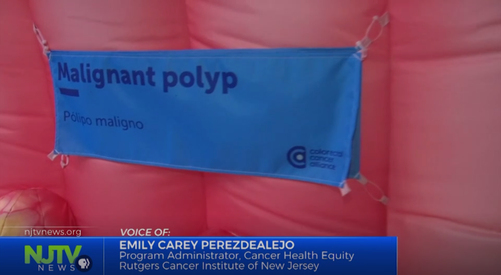 "Screen capture of NJTV video featuring image of inflatable colon with text ""malignant polyp."""